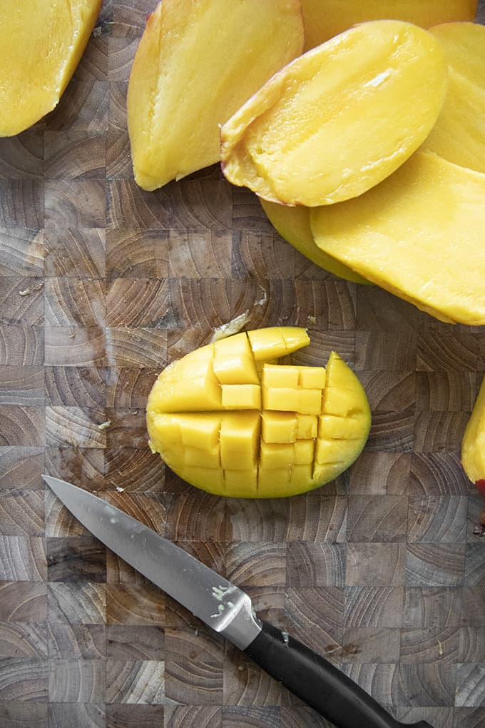 sliced mango on cutting board