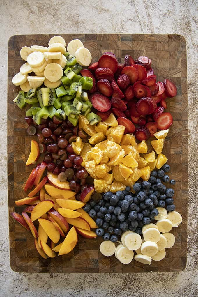 fruit salad ingredients on cutting board