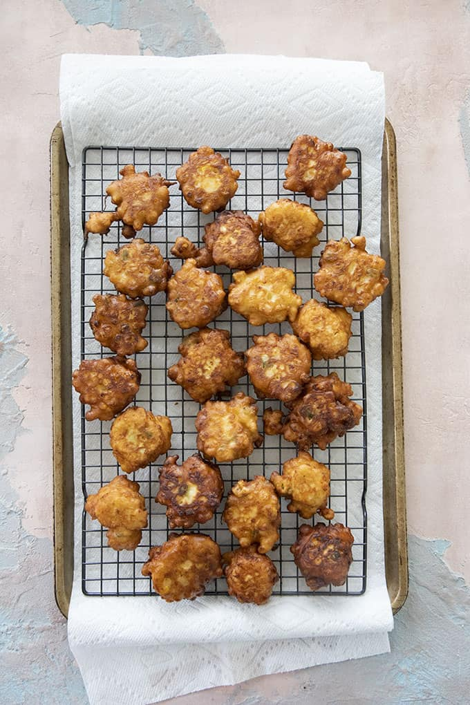 corn fritters on a wire rack
