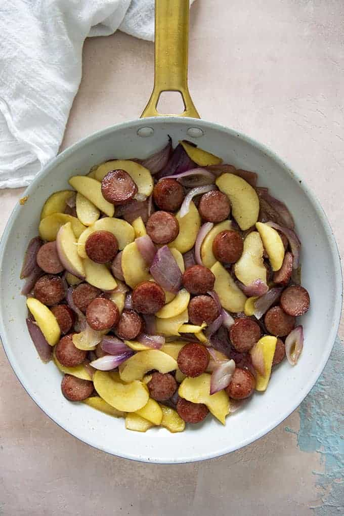 kielbasa apples and onions in a skillet