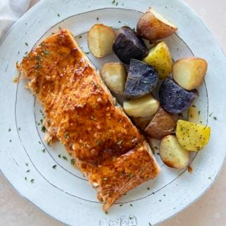 maple salmon on a plate with potatoes